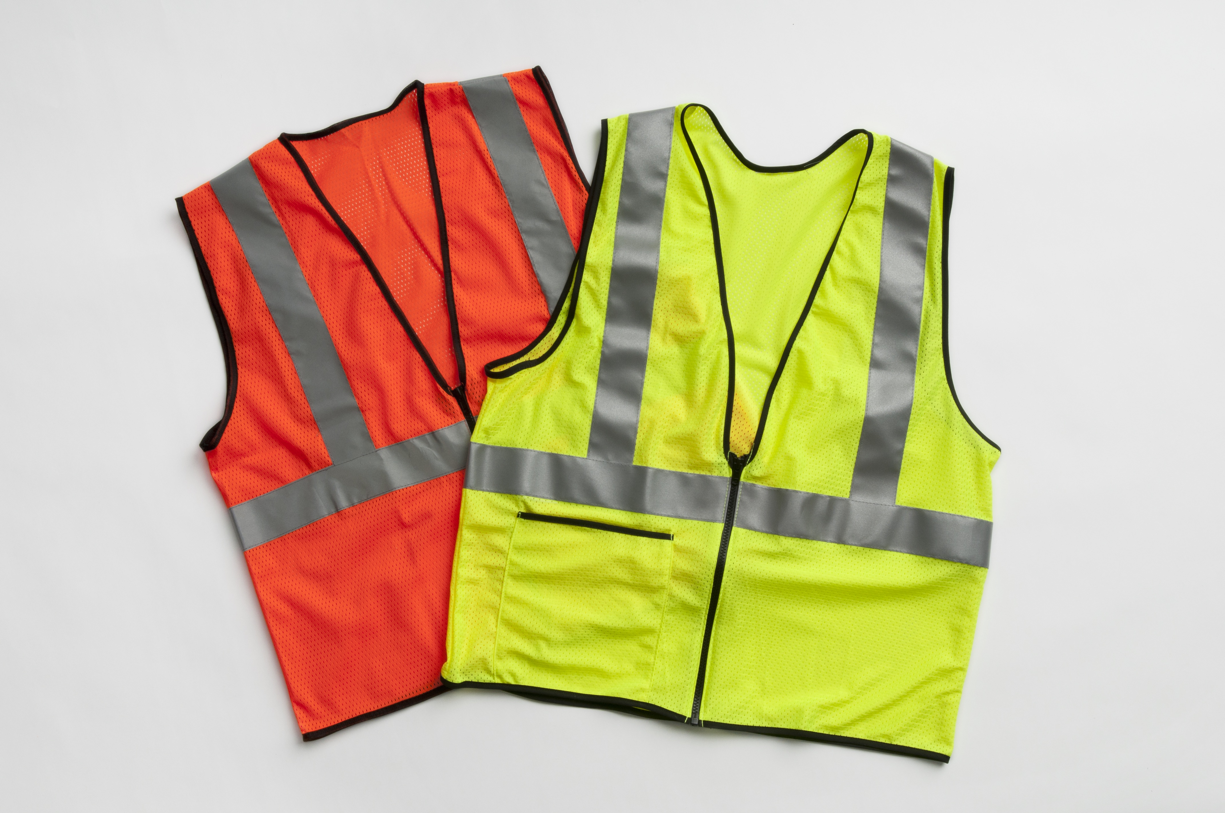 a display of safety vest in orange and yellow