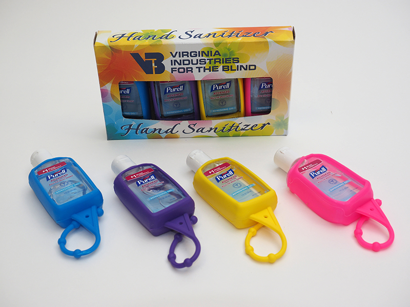 Purell hand sanitizer displayed in carry fobs of various colors